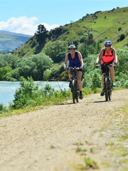 Riders on the  Clutha Gold Trail near the Roxburgh Dam. Photo by Peter McIntosh.