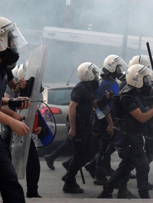 Riot police clash with protesters in Ankara during a demonstration blaming the ruling AK Party...