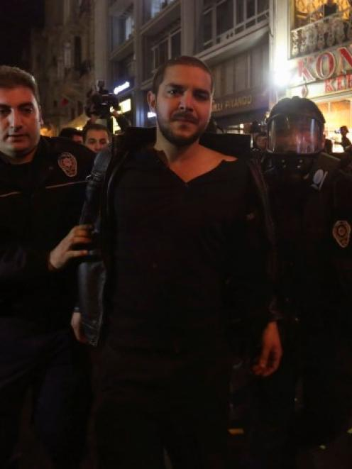 Riot policemen detain a demonstrator during the protest against internet censorship in Istanbul....