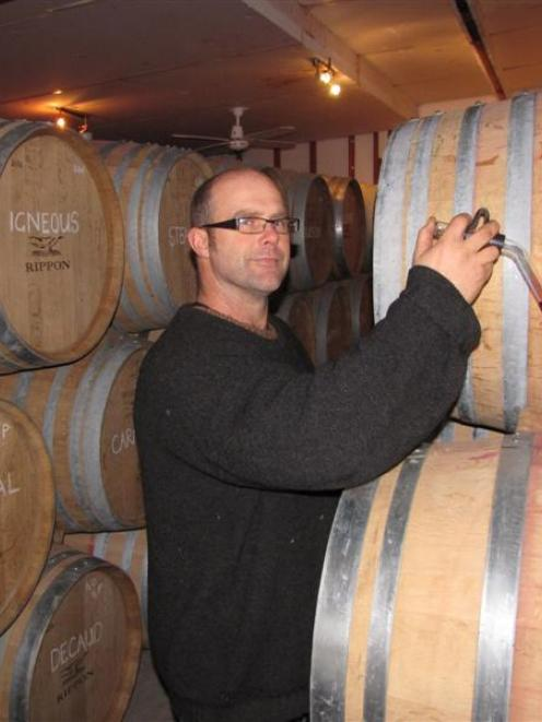 Rippon Vineyard assistant winemaker Brett Reddington takes a sample of the winery's 2013 gamay...