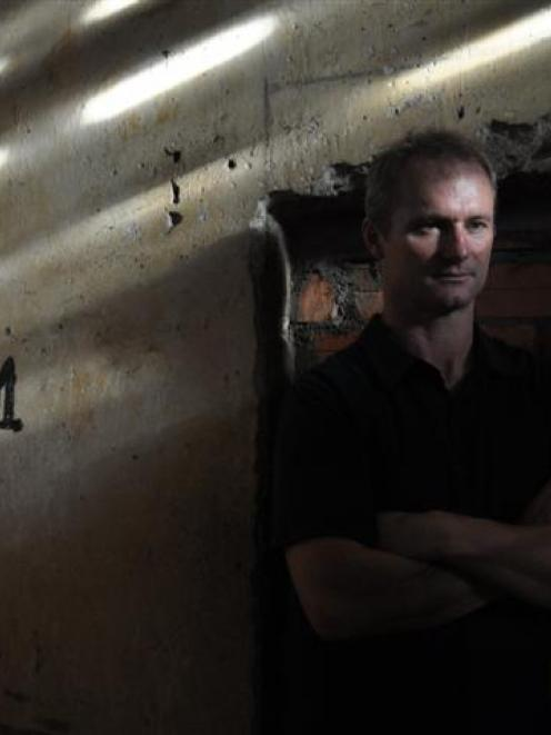 Rob Hamill in a cell at Toul Sleng (S21) prison. Photos supplied.