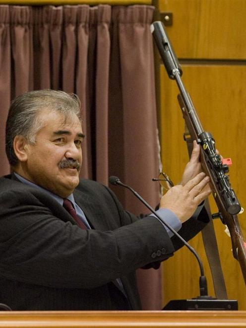Robert Ngamoki, a police armourer, with the rifle used in the Bain murders, at the David Bain...