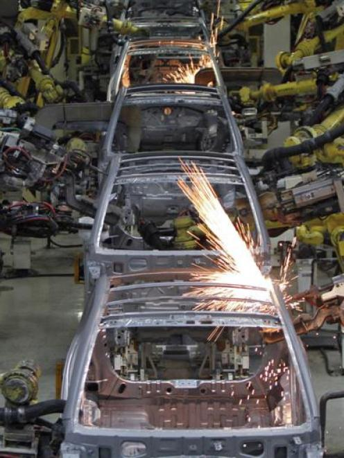 Robot arms assemble cars inside  Hyundai's plant in India. Photo by Reuters.