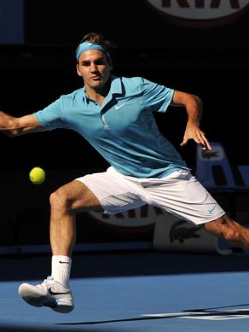 Roger Federer of Switzerland returns to Nikolay Davydenko of Russia in their Men's singles...