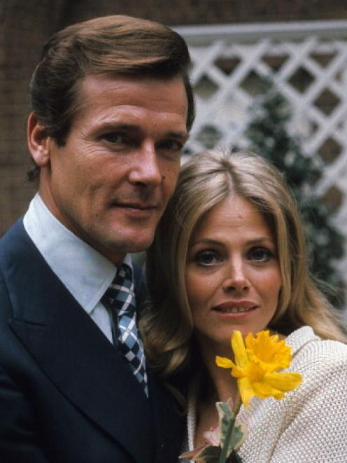 Roger Moore (James Bond) and Britt Ekland (Mary Goodnight) pose on the set of 'The Man With The...