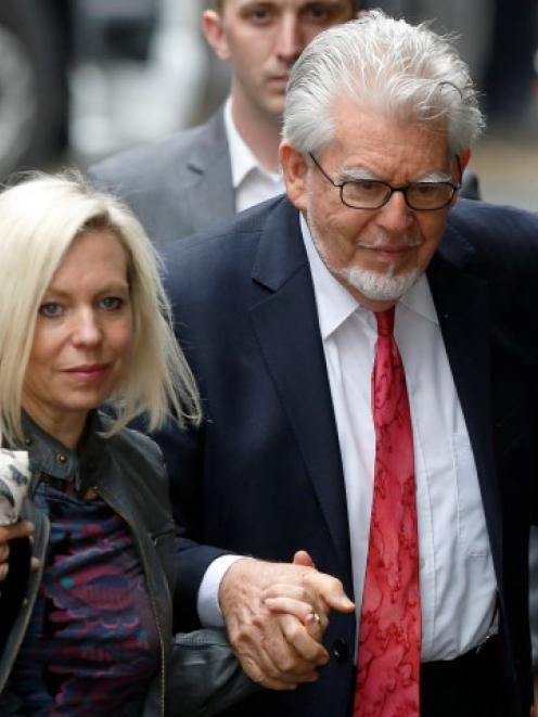 Rolf Harris arrives with his daughter Bindi at Southwark Crown Court in London. REUTERS/Luke...
