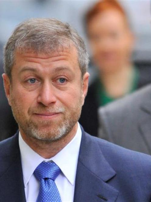 Roman Abramovich arrives at court. REUTERS/Toby Melville