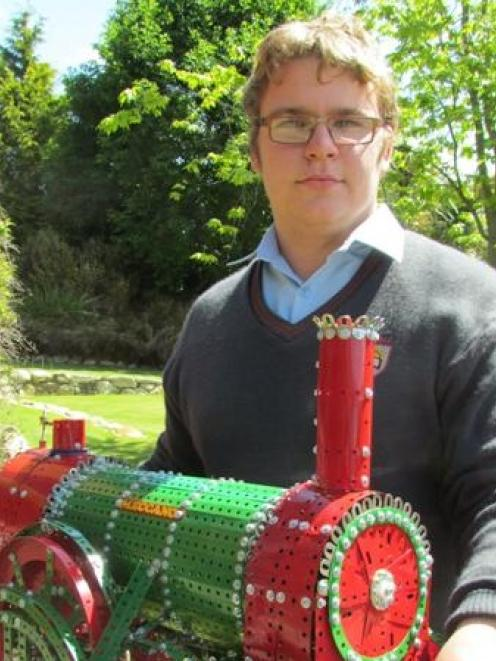 Roman Johnston,  from Weston, shows off one of the Meccano creations that will be on display in...