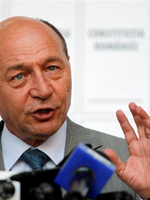 Romania's suspended President Traian Basescu addresses media at his campaign headquarters....