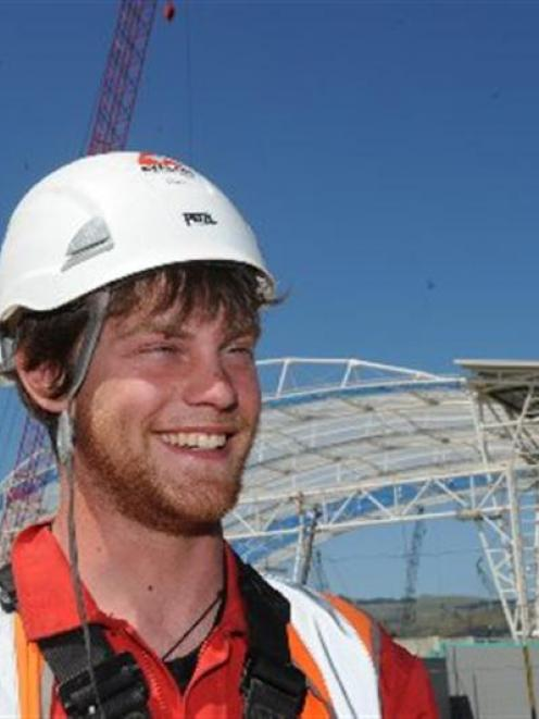 Rope-access technician Chris Price, of England, is one of 11 workers tasked with climbing to the...