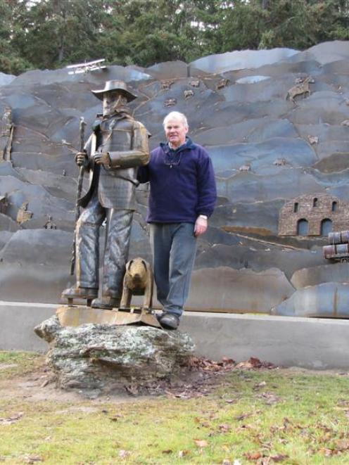 Roxburgh artist Bill Clarke with his monument which marks 150 years of pastoral farming in the...