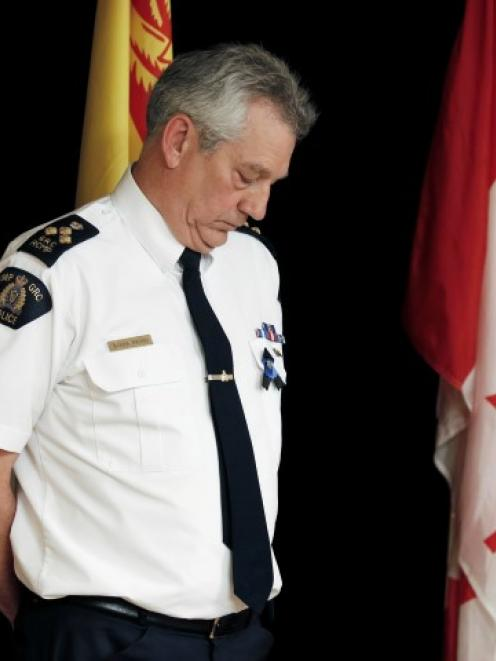 Royal Canadian Mounted Police Commander Roger Brown fronts a news conference in Moncton, New...