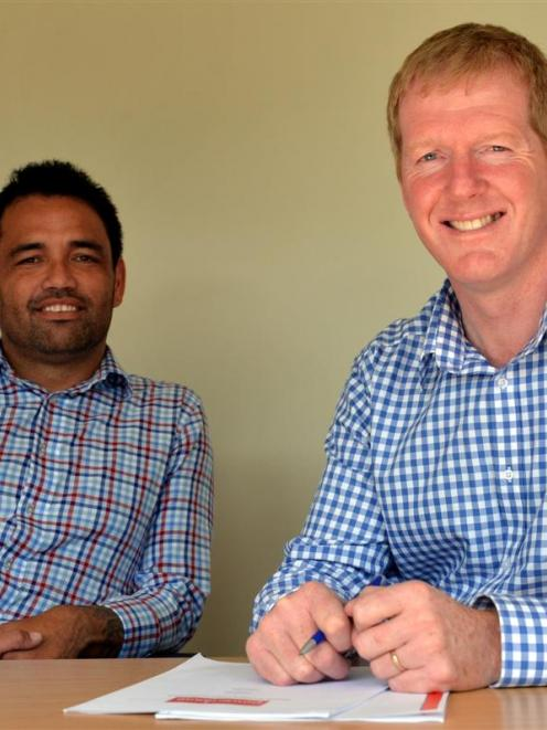 Rueben Skipper (left) and Steve Silvey, from Upstart business incubator, reflect on its merger...
