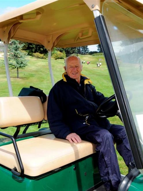 Rules referee Watson Barkman in a typical pose, in the rules golf cart at St Clair yesterday....
