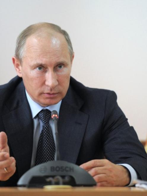 Russia's President Vladimir Putin chairs a meeting on the aftermaths of recent floods in...