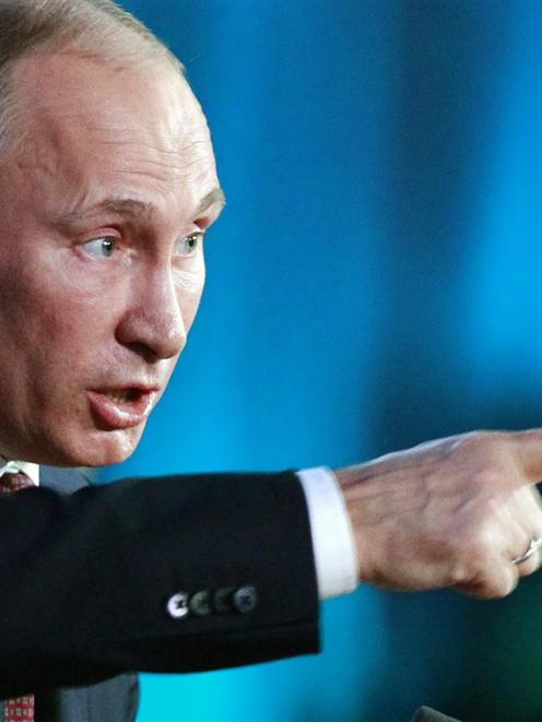Russia's President Vladimir Putin speaks during his annual news conference in Moscow. REUTERS...