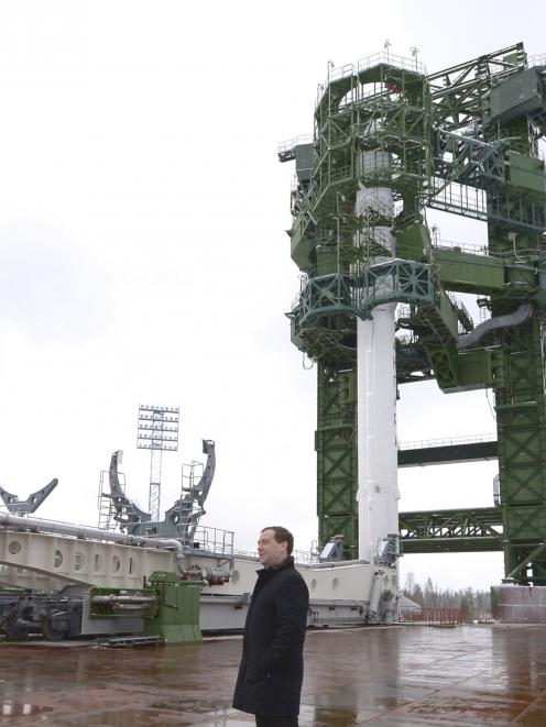 Russia's Prime Minister Dmitry Medvedev inspects the launch pad of the new generation Angara...