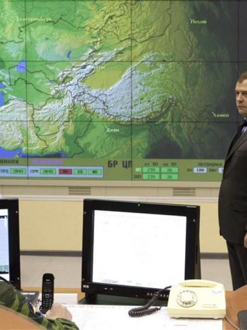 Russian President Dmitry Medvedev (looks on during a visit to an early-warning radar station near...