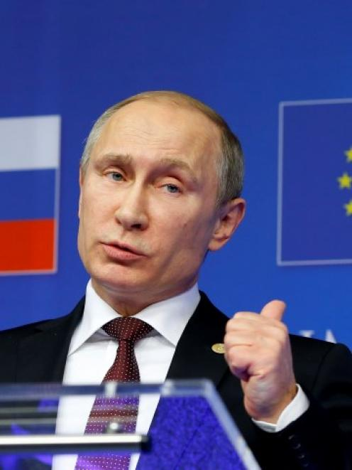 Russian President Vladimir Putin speaks at a news conference after an EU-Russia Summit in...