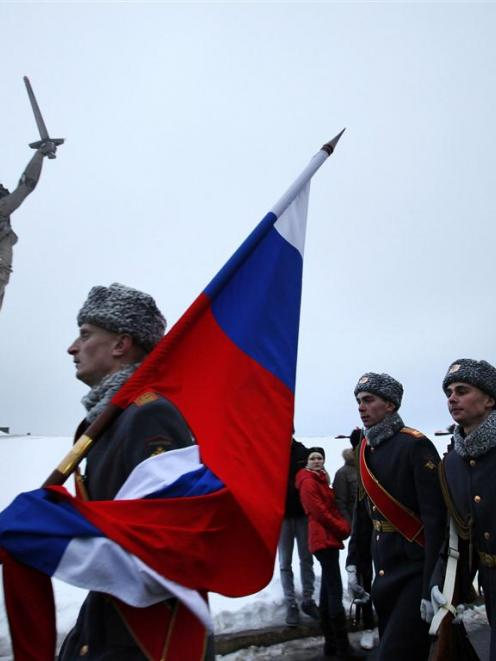 Russian soldiers march at the Mamayev Kurgan (Mamayev Hill) World War Two memorial complex, with...
