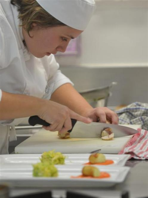 Salon Culinaire competitor Marcela Garvalho, of Queenstown, prepares her poached chicken dish at...