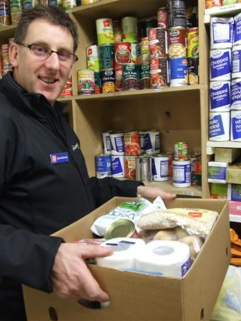 Salvation Army community worker Blair McKenzie in the Camp St store stocks up the Queenstown...