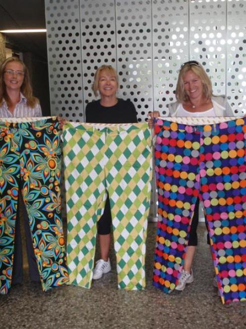 Sam Gent, who manages The Hills, holds up some of the Loudmouth pants she has ordered from the...