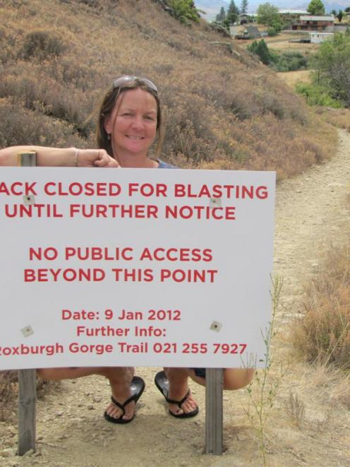 Samantha Rule, of Clyde, cannot run on this track because of blasting work. This sign is at the...