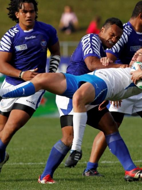 Samoa's Eliota Sapolu Fuimaono tackles Namibia's Theuns Kotze during their match in Rotorua last...