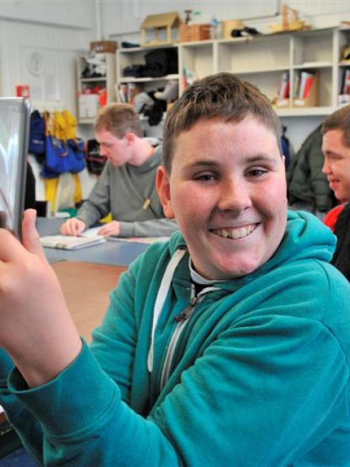 Sara Cohen School pupil Joshua Anderson (18) acquaints himself with a new iPad mini, one of five...