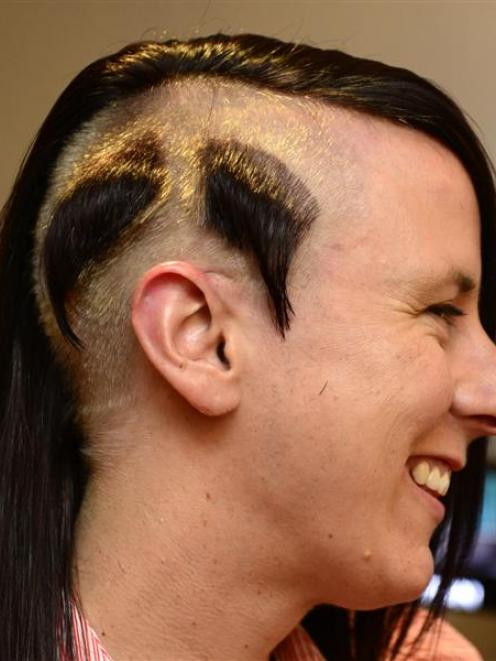 Sarah Naylor shows off the walrus-style moustache shaved out of  her hair yesterday in memory of...