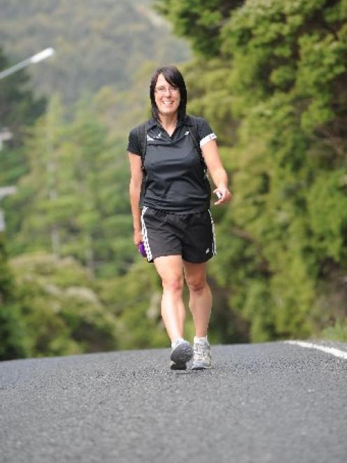 Sarah Naylor takes the last steps in her bid to walk down every street in Dunedin City. Photo by...
