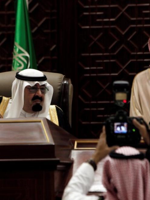 Saudi King Abdullah bin Abdulaziz al-Saud (seated on L) attends a Shura assembly in Riyadh...