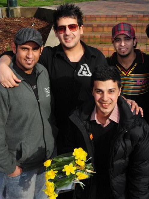 Saudi Student Club president Bassam Andijani with Christchurch earthquake evacuees Khalid Bib...