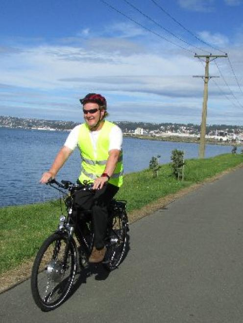 Sawyers Bay resident Prof Samuel Mann enjoys the tranquillity of the West Harbour cycleway...