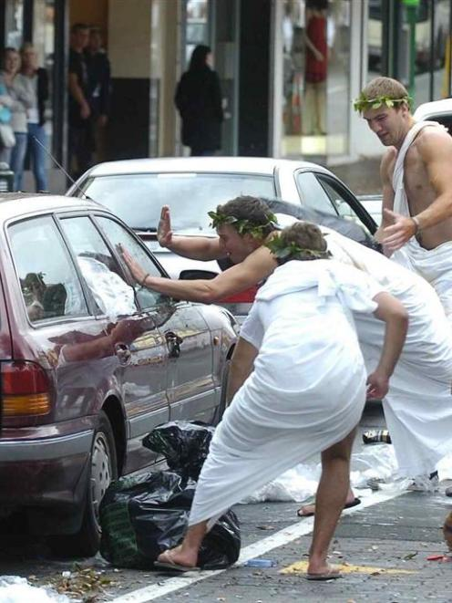 Scenes from Tuesday's toga parade which spiralled out of control. ODT files