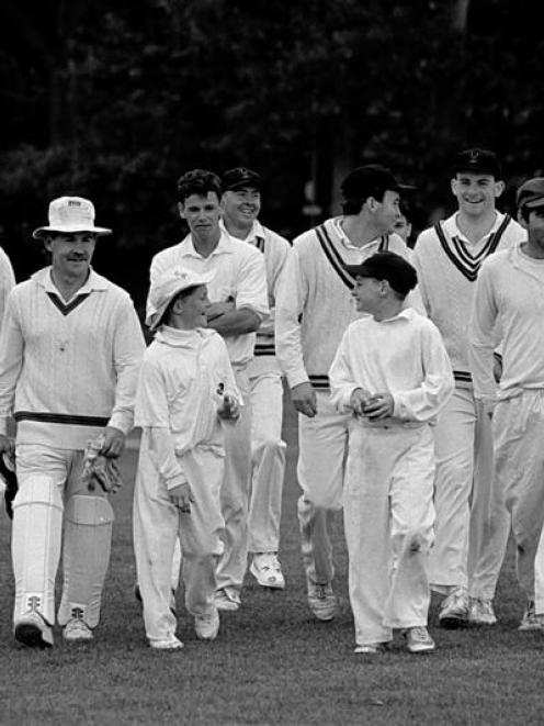 Schoolboy brothers Brendon (left) and Nathan McCullum lead their Albion senior cricket team-mates...