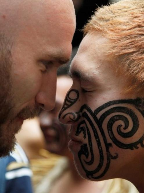 Scotland's Ally Strokosch (L) exchanges a hongi with a local after arriving at Invercargill...