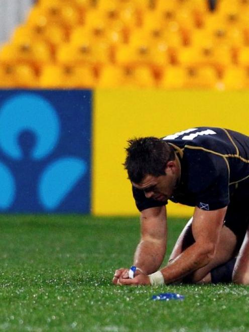 Scotland's Sean Lamont reacts after losing their Rugby World Cup Pool B match against Argentina...