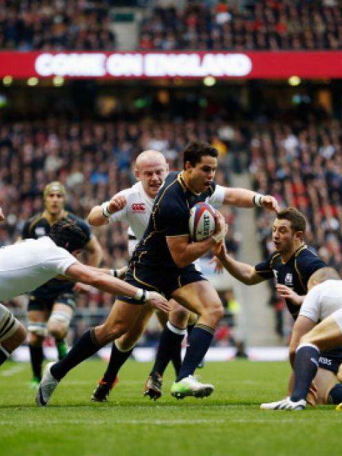 Scotland's Sean Maitland runs at the English defence during their match at Twickenham in London. ...