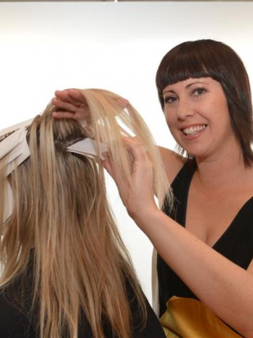 Scott Base colourist Amanda Buckingham uses her new biodegradable hair product, made from rock...