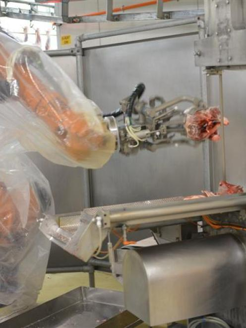 Scott Technology meat industry robotics, at work  at Silver Fern's Finegand plant. Photo by...