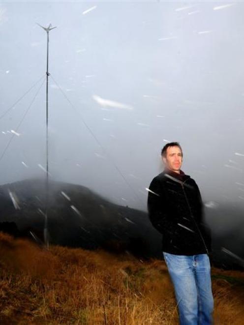 Scott Willis with the wind turbine Waitati hopes will lead to a better future. Photo by Craig...