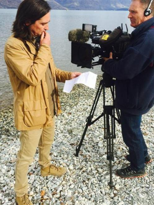 Scottish television personality Neil Oliver films with cameraman Jeff Aldridge on the Queenstown...