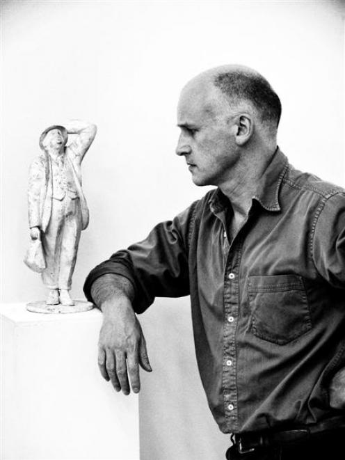Sculptor Martin Jennings looks at  a maquette for a statue of Sir John Betjeman. A similar-sized...