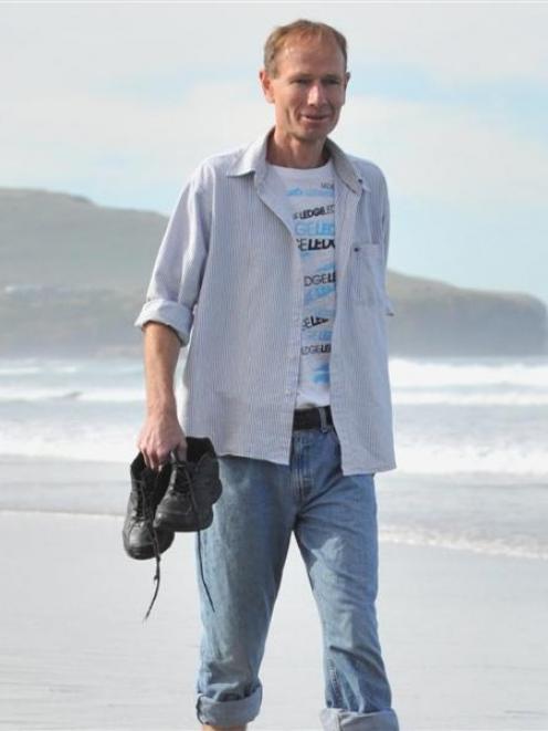 Sean Davison walks on St Clair Beach, Dunedin, after completing his  home detention sentence....