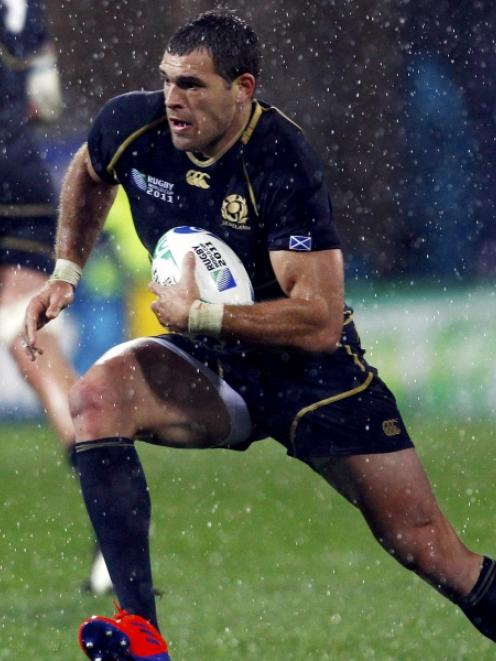 Sean Lamont, part of Scotland's revamped backline. Photo by Reuters.