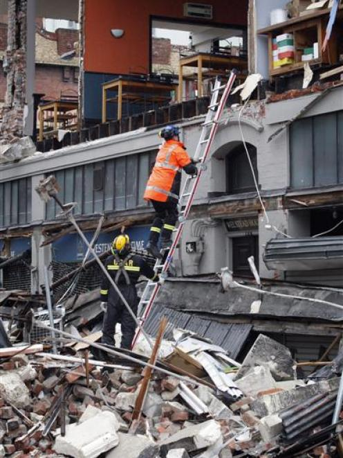 Search and Rescue teams work to temporarily secure a building on the corner of Worcester and...