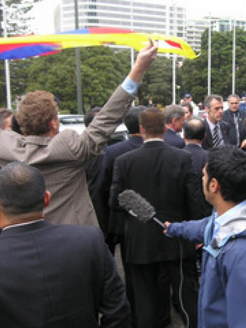 Greens co-leader Russel Norman flies the Tibetan flag as China's Vice President Xi Jinping...