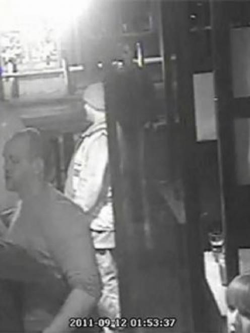 Security camera shows England Rugby player Mike Tindall getting close to an unknown blonde while...